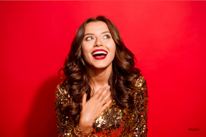 Smiling woman with white teeth on red background