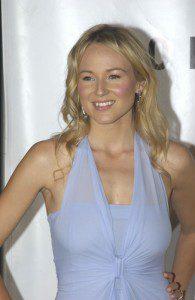Singer Jewel smiling wearing purple top