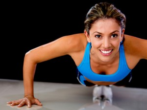 Woman smiling while doing a push up