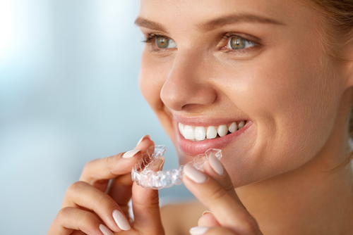portrait of beautiful smiling woman with healthy straight white teeth