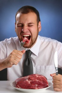 man eating steak