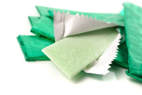 chewing gum and the wrapping foil on white-img-blog