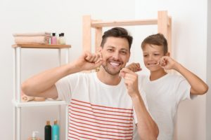 Father and son flossing together