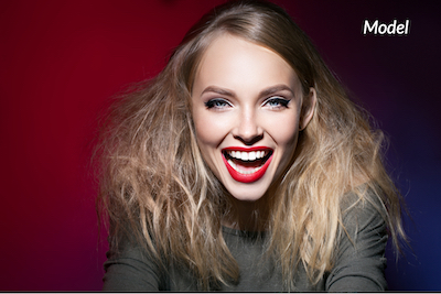 A woman showing off her white teeth after receiving Zoom! Teeth Whitening.